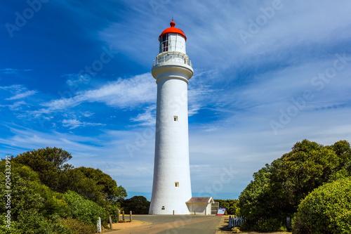 Keuken foto achterwand Vuurtoren Picturesque white lighthouse