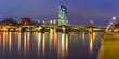 Picturesque panoramic view of Frankfurt am Main skyline during evening blue hour with mirror reflections in the river, Germany