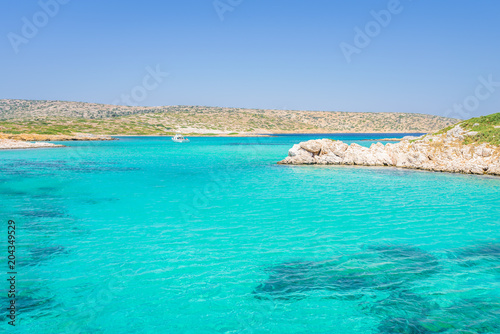 Wall Murals Green coral White Island, Aspronisi, Leros Island, Dodecanese, Greece: Amazing view to maldives beach bay like small greek island with crystal clear turquoise blue water some boats cruising and people swimming