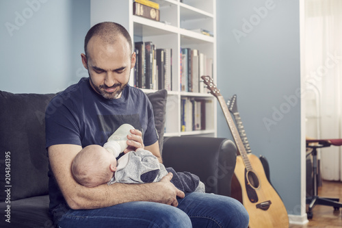 Father feeding baby Canvas Print