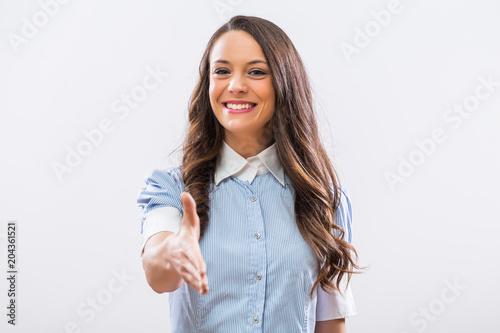 Valokuva  Image of beautiful businesswoman  showing handshake gesture.
