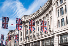Close Up Of Buildings On Regent Street London UK Photographed From Street Level, With Row Of British Flags To Celebrate The Royal Wedding Of Prince Harry To Meghan Markle.
