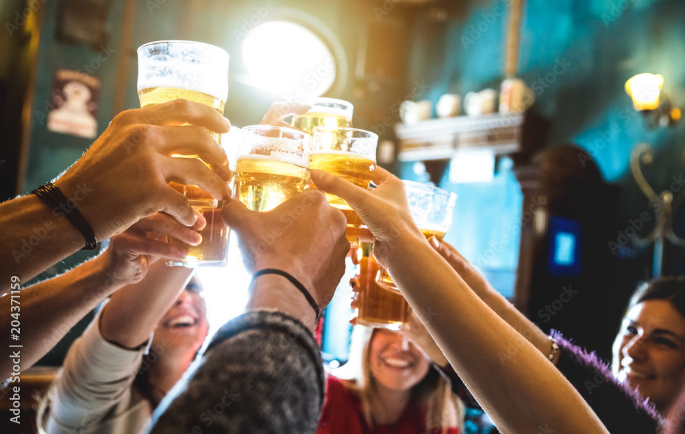 Fototapety, obrazy: Group of happy friends drinking and toasting beer at brewery bar restaurant - Friendship concept with young people having fun together at cool vintage pub - Focus on middle pint glass - High iso image