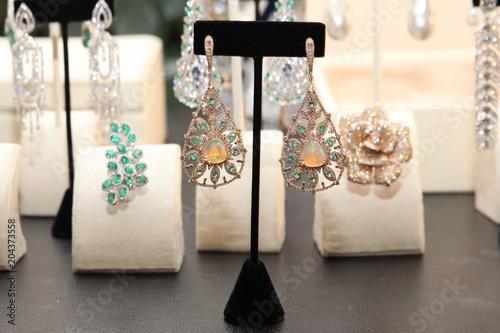 Fotografia, Obraz  Earrings huge, multi-tiered with diamonds, emeralds and moonstone