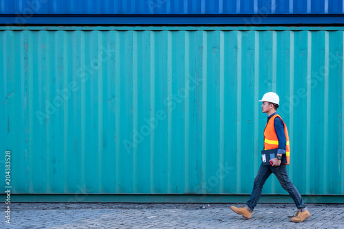 Tela  The abstract image of the engineer walking in shipping container yard and copy space