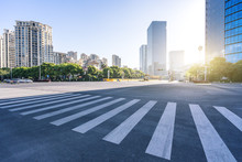 Asphalt Road With Panoramic Cityskyline