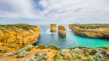 12 Twelve Apostels, Melbourne, Port Campbell National Park, Australia: Beautiful Famous Coast View To The Wild Bass Strait, Rocky Erosion Cliffs Of The Great Ocean Road Sandstone Limestone Formation