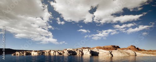 Clear lake on the coastline of an arid landscape.