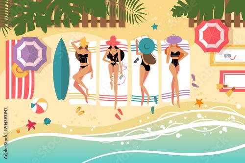 Papiers peints Restaurant Cute girls sunbathing on beach