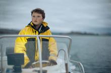 Pre-adolescent Boy Steers A Bo...