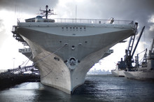 Military Ship Moored In A Comm...