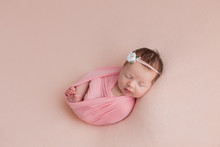 Newborn Girl. Newborn Photo Shoot. Newborn Baby In Pink On Pink Background