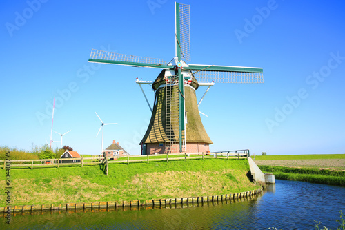 Poster Artistic monument The historic windmill Goliath in Friesland, North Sea coast, Province Groningen, the Netherlands