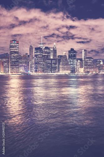 In de dag New York City Vintage toned Manhattan skyline at night, New York City, USA.