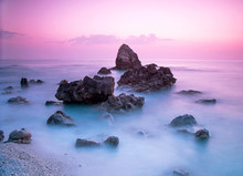 A Picturesque Magical Mystical Beautiful Scenery With Waves And Stones In The Middle Of The Sea On The Coast At Sunset. (meditation, Antistress, Relaxation - Concept)