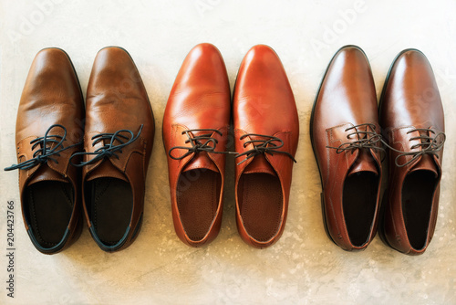 Men shoes collection - different models and brown colors Plakat