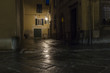 Nocturnal Old Town streets with street lighting in the Tuscan city of Lucca in Italy