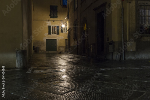 Printed kitchen splashbacks Narrow alley Nocturnal Old Town streets with street lighting in the Tuscan city of Lucca in Italy