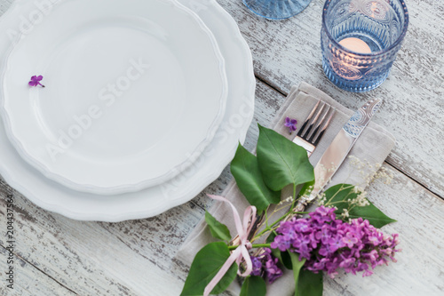 Rustic table setting with lilac flowers