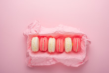 Macaroons In A Box On A Light Pink Background, Flatlays, With An Empty Space For Writing On A Postcard Or Congratulations