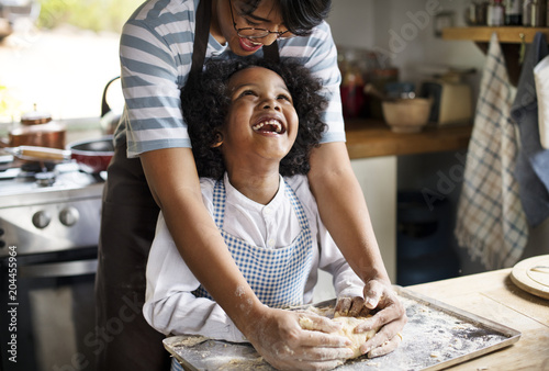 Mother and son baking Wallpaper Mural