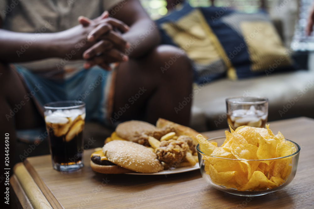Fototapety, obrazy: Fast food on a sofa table