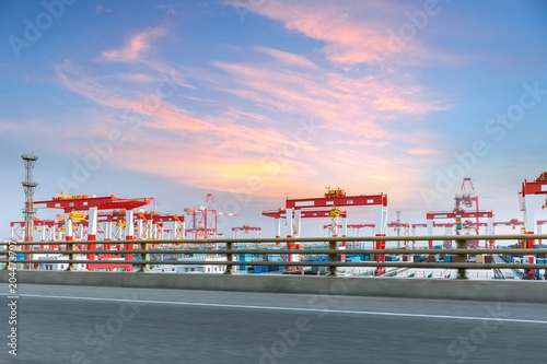 Foto op Canvas Poort container terminal with highway