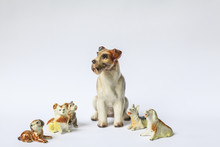 Decorative Porcelain Dogs Isolated On A White Background