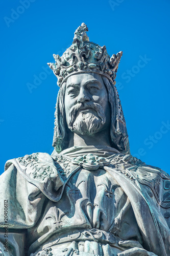 Staande foto Historisch mon. Statue of King Charles IV at Charles (Karluv most) Bridge Tower arched gateway in Prague, Czech Republic