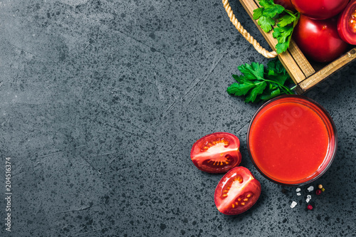 Stickers pour porte The Salty tomato juice in glasses on dark concrete background. Top view, space for text.