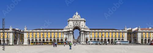 Lisbon, Portugal - April 14, 2013: Praca do Comercio aka Terreirro do Paco Square with the famous Triumphal Arch of Rua Augusta Street. Baixa District