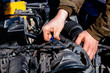 man's hands closeup and car parts, car repair