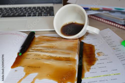Fotografering  Spilled coffee on the desktop