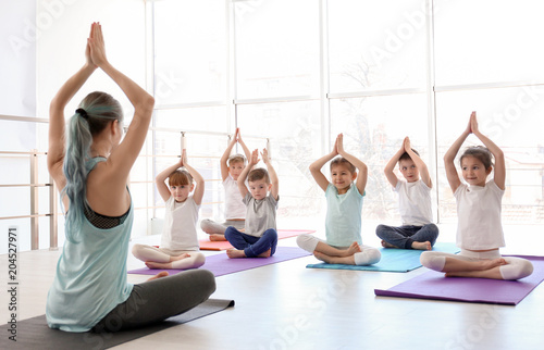 Printed kitchen splashbacks Yoga school Little children and their teacher practicing yoga in gym