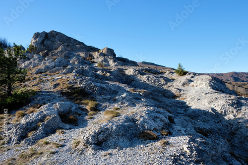 Staande foto Nachtblauw Rock path and blue sky in North Italy