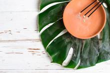 Burning Aromatic Incense Sticks. Ceramic Dish And Monster Leaf