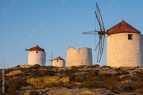 A series of deserted windmills at the top of Chora of Amorgos Canvas Print