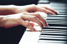 Close Up Of Woman Hands Playing And Practicing Piano