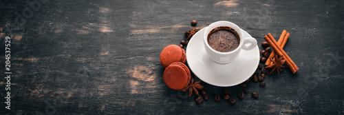 Foto op Plexiglas Chocolade Macaroons and a fragrant cup of coffee. Top view. On a wooden background. Copy space.