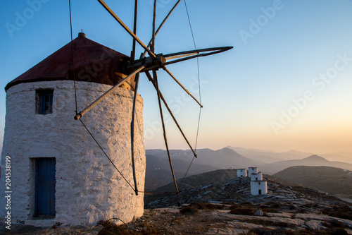 A windmill at the top of the Chora of Amorgos with a series of deserted windmill Canvas Print