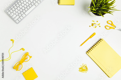 Office table with yellow office supplies