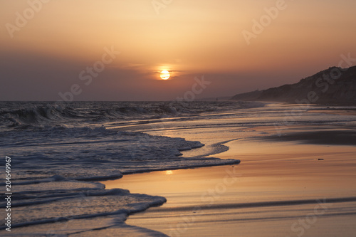 Sunset Reflexion on the beach , Mazagon , Huelva , Andalusia , Atlantic coast , Spain