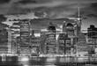 Black and white picture of Manhattan skyline at night, New York City, USA.