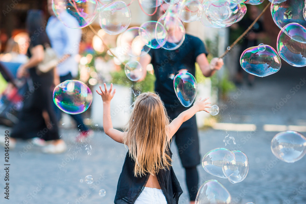 Fototapety, obrazy: Adorable little girl blowing soap bubbles in Trastevere in Rome, Italy
