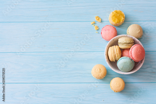 Poster  Assortment of macarons on blue wood background