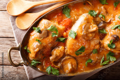 Chicken chasseur is a classic French dish with mushrooms and tomatoes in smooth sauce close-up Fototapeta