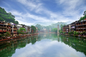 Fototapeta na wymiar HUNAN, CHINA - JUNE 16, 2014 : Old houses in Fenghuang county in Hunan, China. The ancient town of Fenghuang was added to the UNESCO World Heritage Tentative List in the Cultural category.