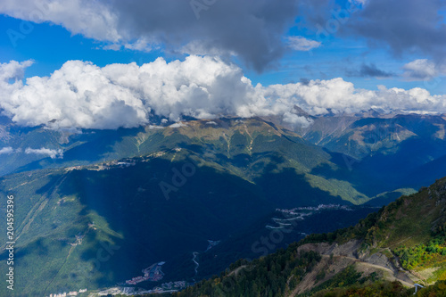 Staande foto Nachtblauw Mountain landscape against cloudy blue sky in Krasnaya Polyana Sochi