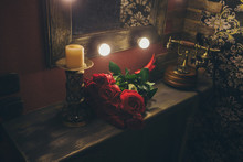 On The Shelf In Front Of The Mirror Are: Chandelier With Candle, Vintage Phone And Red Roses