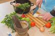 Man hands cutting vegetables on kitchen blackboard. Healthy food. Male preparing vegetables